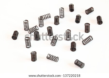 Many spring coils isolated on white background - stock photo