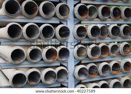 many stacked drain pipes on a construction site