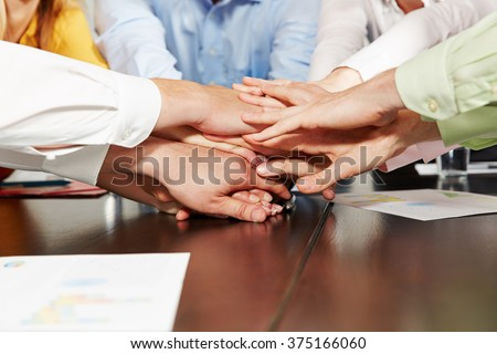 Many stacked hands as teamwork concept for business people in the office