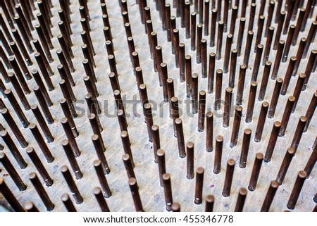 many stainless steel nails forming fakir 's bed, photo taken from above and from the side