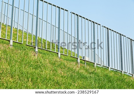 Many steel guards with green grass and blue sky