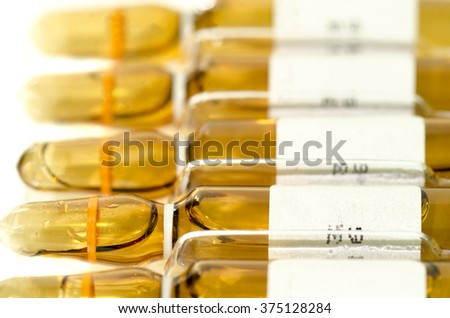 Many sterile vial and ampule filled with injection dosage form medication solution isolated on white background - stock photo