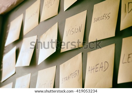 many sticky notes attached to blackboards with handwriting text, business and coaching concept - stock photo