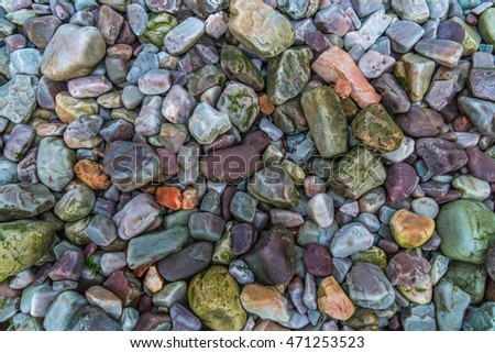 Many stones on the beach, Sea pebbles, background