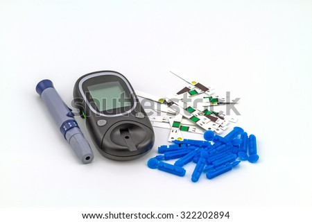 Many strip test of blood glucose meter, the blood sugar value is measured on a finger on white background - stock photo