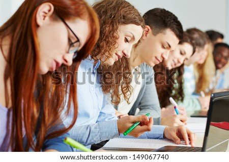 Many students learning together in a school class - stock photo