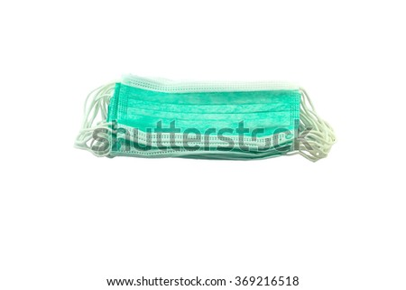 Many surgical ear-loop mask stack on white background  - stock photo