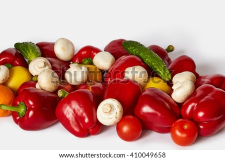 Many sweet ripe vegetable, fruits and mushrooms are on a white background - stock photo