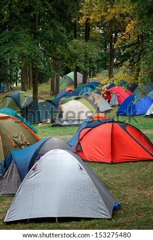 Many tents at a festival campsite  - stock photo