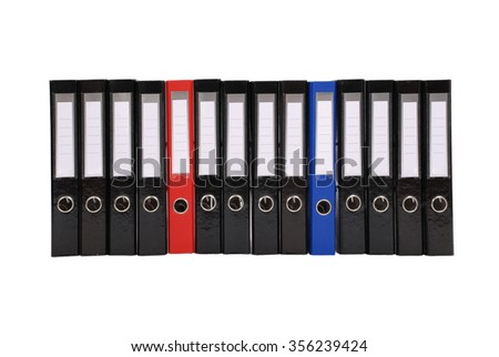 Many the big black folders on a white background. One red folder and one blue folder. - stock photo