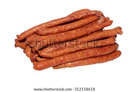 Many thin smoked sausage on white background - stock photo