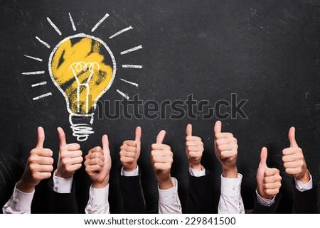 many thumbs up to an idea - stock photo