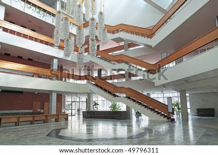 Many-tier stairs in the big office building - stock photo