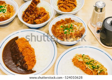 Many Tonkatsu or katsudon. Japanese deep-fried pork cutlet with egg and rice.