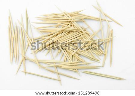 Many toothpicks on a white background - stock photo