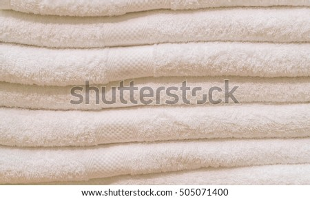 many towel stack on shelf