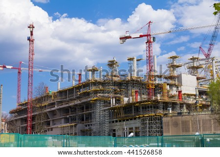 Many Tower Cranes at Construction site. - stock photo