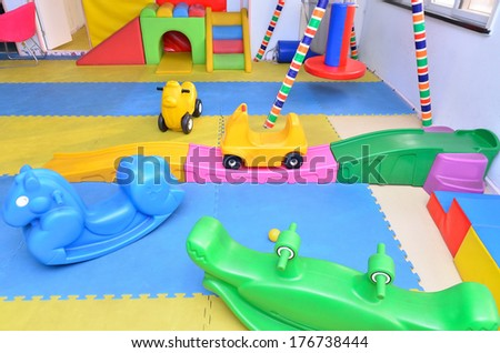 Many toys in the children's playroom of a kindergarten  - stock photo