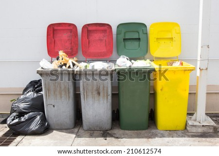 Many trash ,Pile of garbage and overfilled recycle bins - stock photo