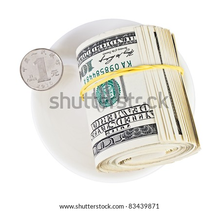 Many US dollars rolled up versus one chinese yuan coin on white plate, currency concept photo - stock photo