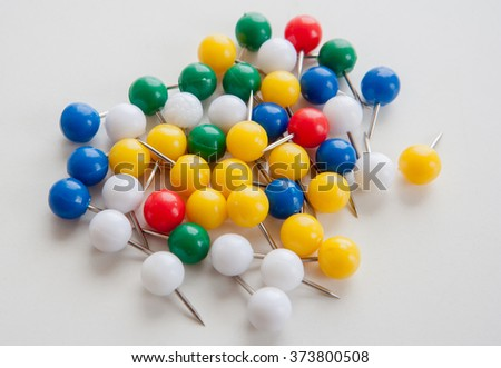 Many varicolored spherical plastic push pins