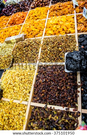 Many varieties of raisins on the counter. Market