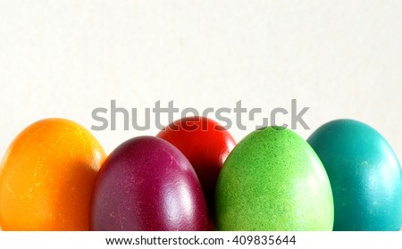 many various colorful easter eggs in row background - stock photo