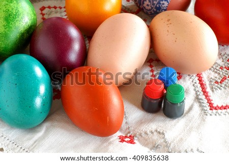 many various colorful easter eggs with liquid paint bottles - stock photo