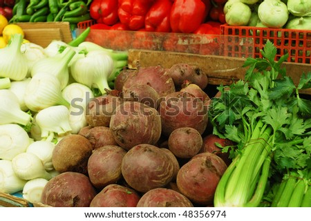 many vegetables on market stand