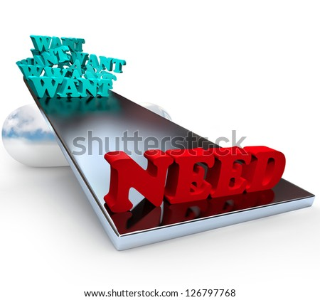 Many wants are outweighed by need on a scale - stock photo