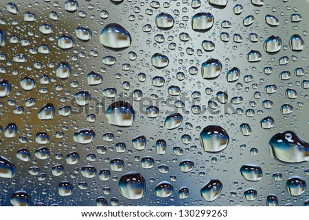 Many water drop on glass wall background