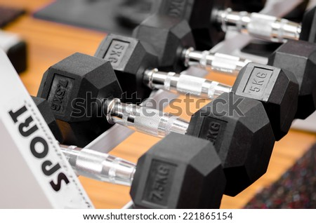 Many  weights arranged in a  rack  - stock photo
