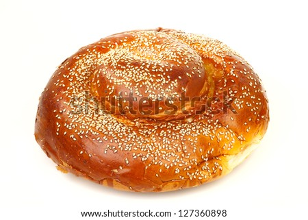 Many white seeds on a round sabbath challah isolated on white background - stock photo