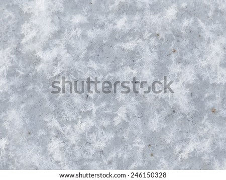 many white snowflakes on old painted metal - stock photo