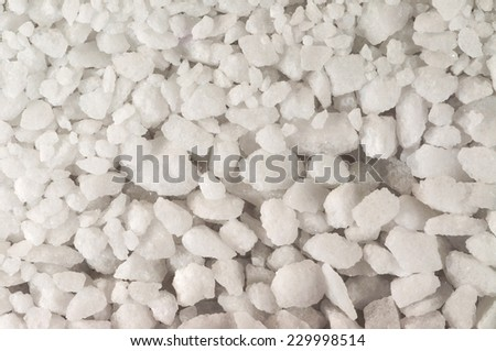 Many white sugar crystal in a large stack - stock photo