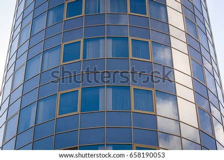 Many Windows in high building.