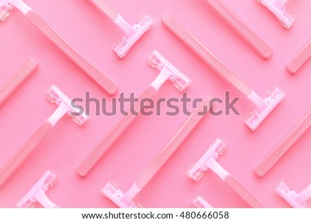 many women razors on the pink background