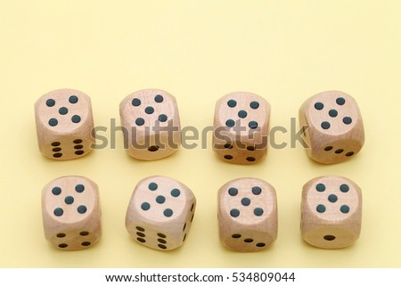 Many wooden dice on a yellow background