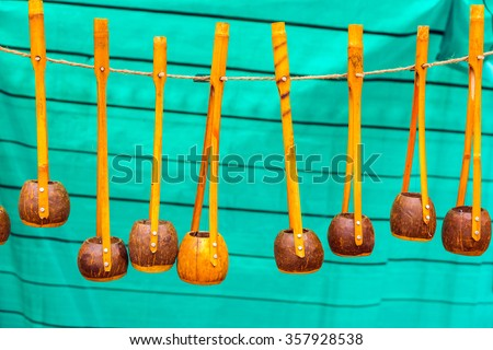 Many wooden Ektara instruments hanging in display for sale. These instruments are used in classical Baul folk music in India. - stock photo
