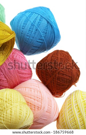 many yarn ball on white background