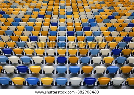 Many yellow and blue seats in a football stadium. Championship, football, places for spectators. - stock photo