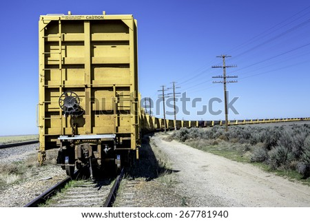 Many yellow train cars abandoned and parked - stock photo