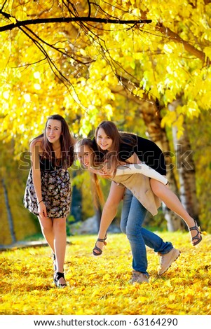 many young girls in the park. View from top. - stock photo