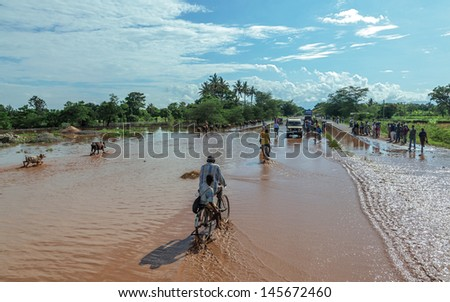 MANYARA, TANZANIA - NOVEMBER 28: The catastrophic debris flow destroyed a road between national parks Manyara and Ngorongoro. Car traffic was restored on the same day, on November 28, 2011 in Manyara - stock photo
