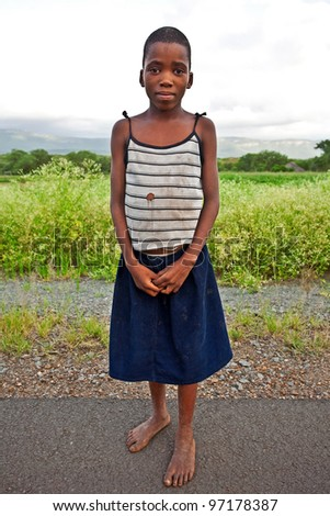 MANZINI, SWAZILAND-DEC 27: Portrait of unidentified Swazi girl on Dec 27, 2007 in a small village near Manzini, Swaziland. Close to 10% of Swaziland's total population are orphans, due to HIV/AIDS. - stock photo