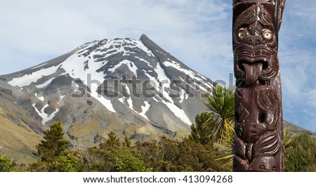 Maori statue in front of Volcano Taranaki, New Zealand