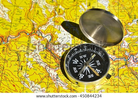 Map and compass - the tools for navigation.  - stock photo