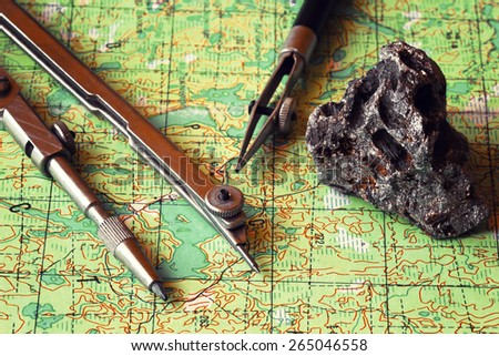 Map and compasses. Travel planning. - stock photo