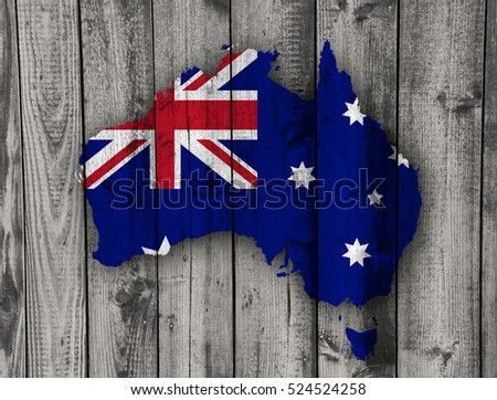 Map and flag of Australia on weathered wood