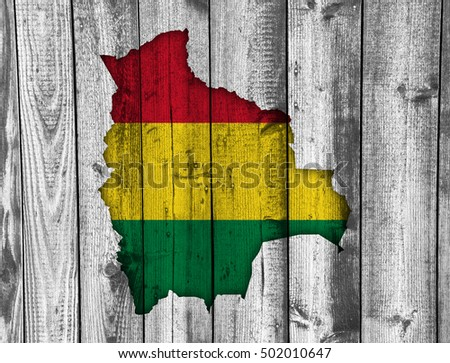 Map and flag of Bolivia on weathered wood